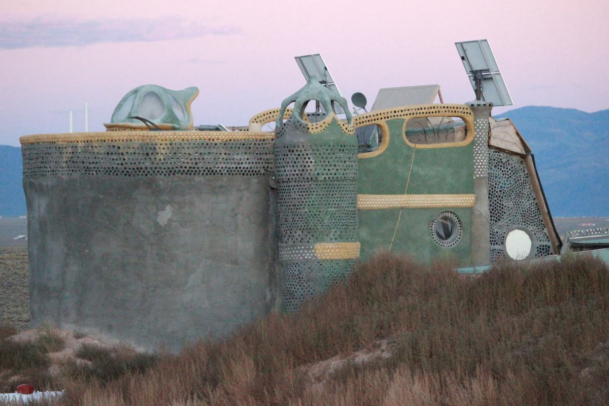 Earthship near Taos, New Mexico.  You can see the individual stye of each builder in their Earthship.