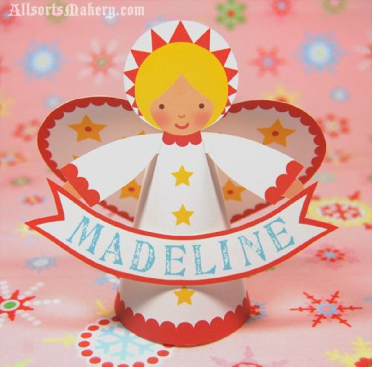 You can find the template you need to print out this cute little Angel at allsorts.typepad.com.
