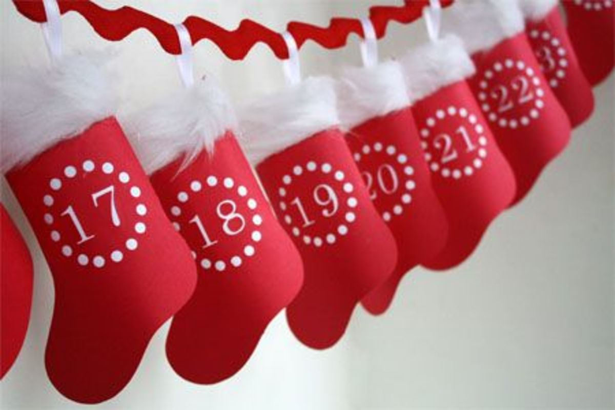 A Printable Hanging Stocking Advent Calendar I Found At Skiptomylou.org!  I love it.