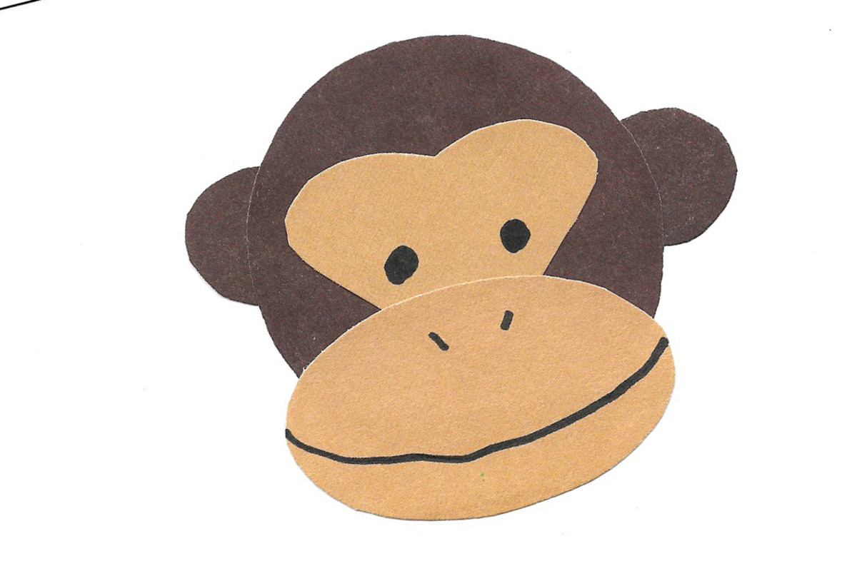 Monkey face made from cut paper shapes -- Year of the Monkey