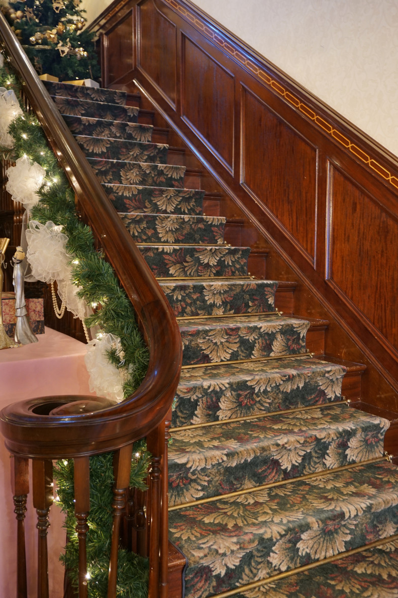Main Staircase of Christmas Season Felt Mansion with Mahogany Woodwork Inlaid