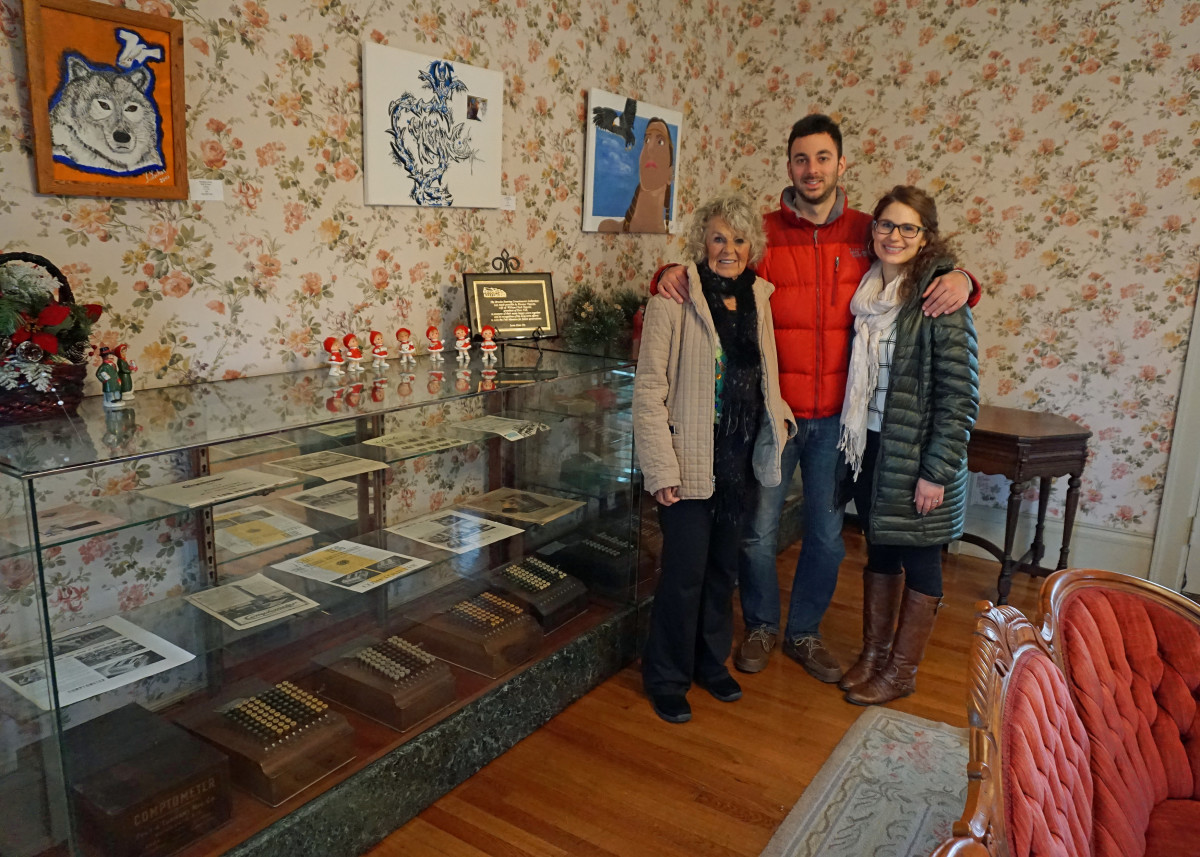 Felt Mansion Display Case of Comptometers. My mother went to Comptometer School in the 40's. (Pictured here with my son and fiance)