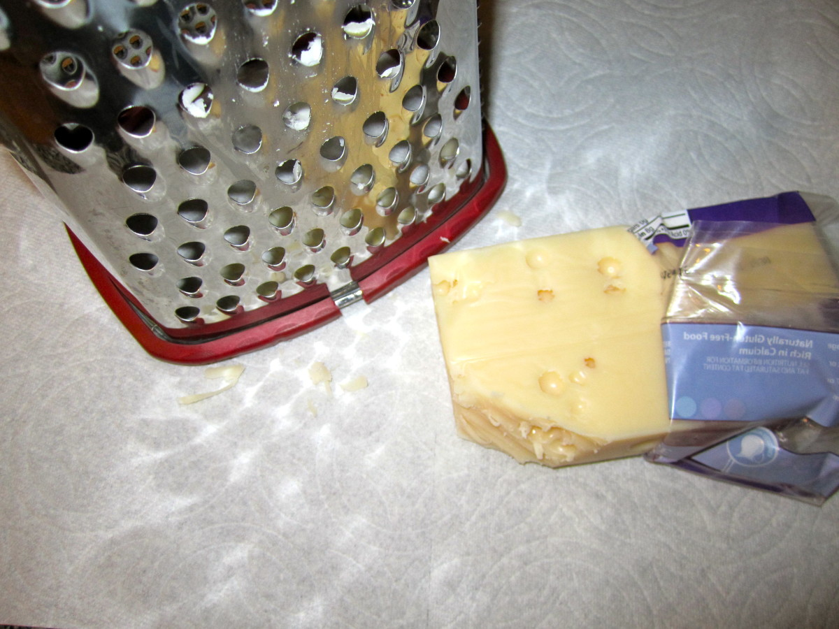 Swiss cheese being grated.