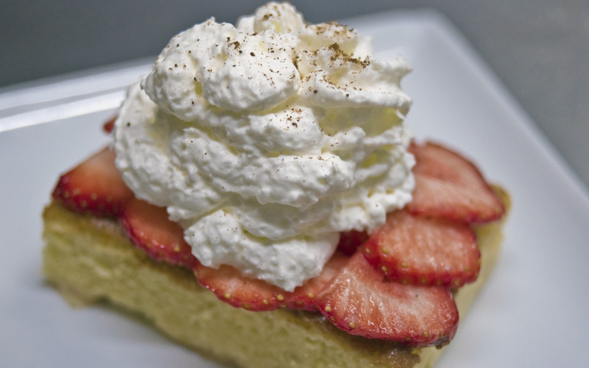 Tres leches cake with fresh strawberries.