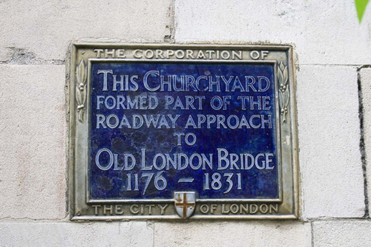 Early blue plaque marks the entrance through the churchyard of St Magnus the Martyr to the Old London Bridge of AD 1175-1831 when the predecessor to the modern London Bridge was built