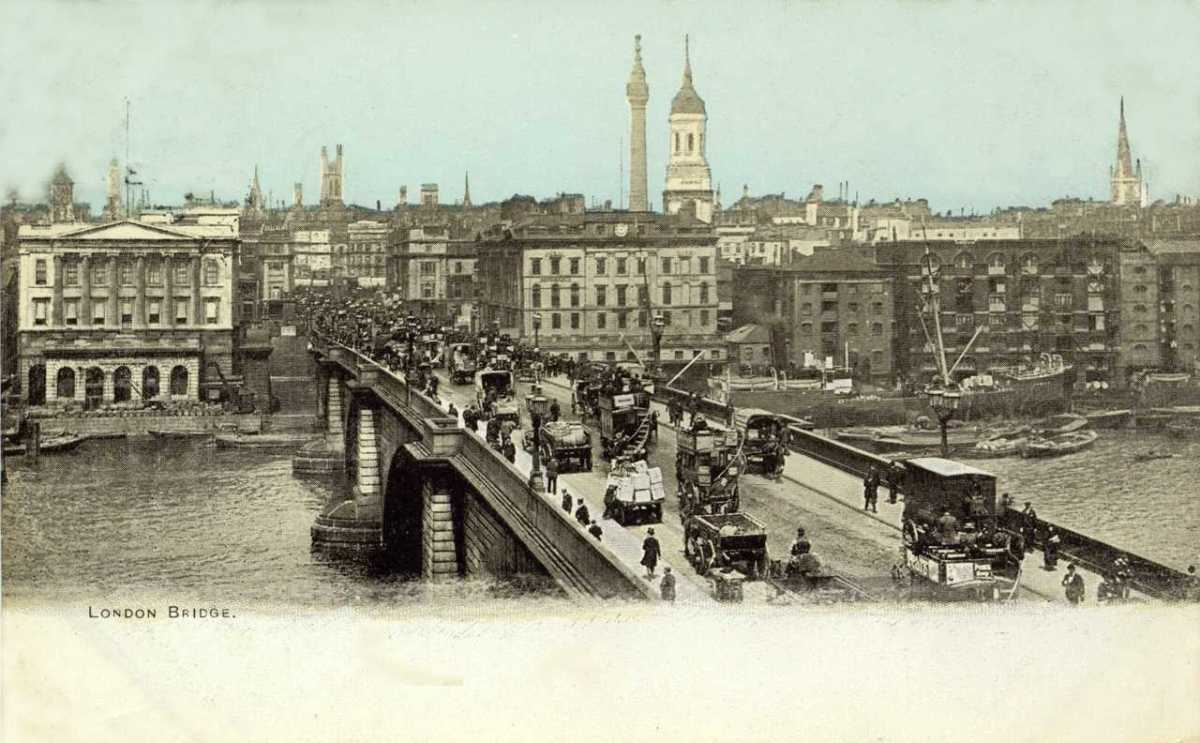 The bridge built in 1831 (William IV) and relocated in 1973 to Lake Havasu, Az (someone thought they'd bought Tower bridge?). Seen here looking from SE1 towards the City early 20th Century