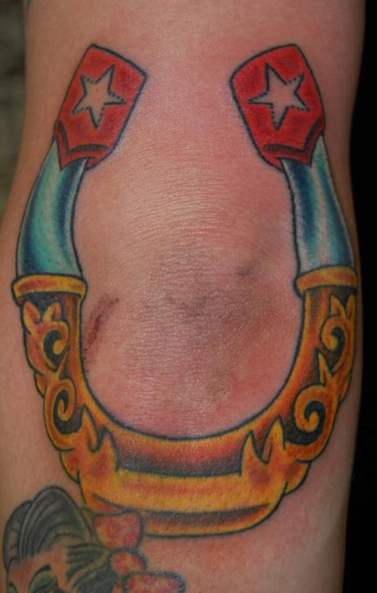 Horse Shoe tattoo of Good Luck and Bad