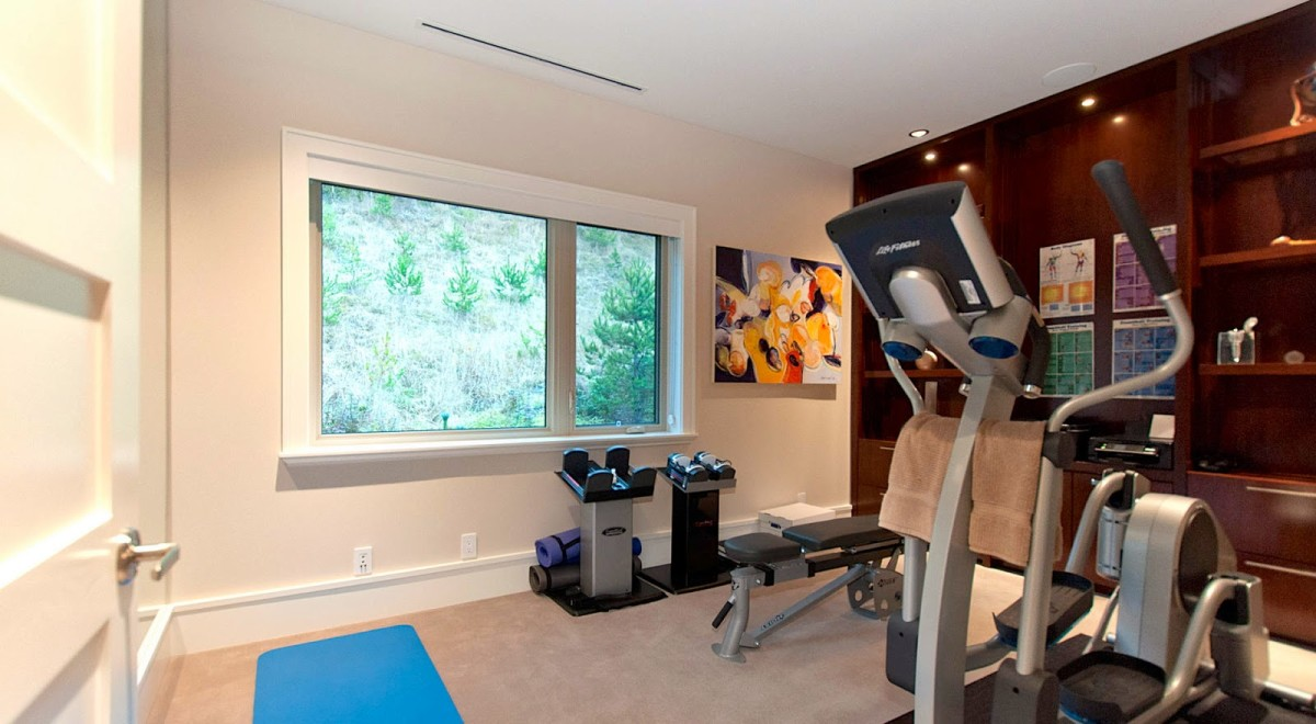 Rich Wood Bookcase in Fitness Room