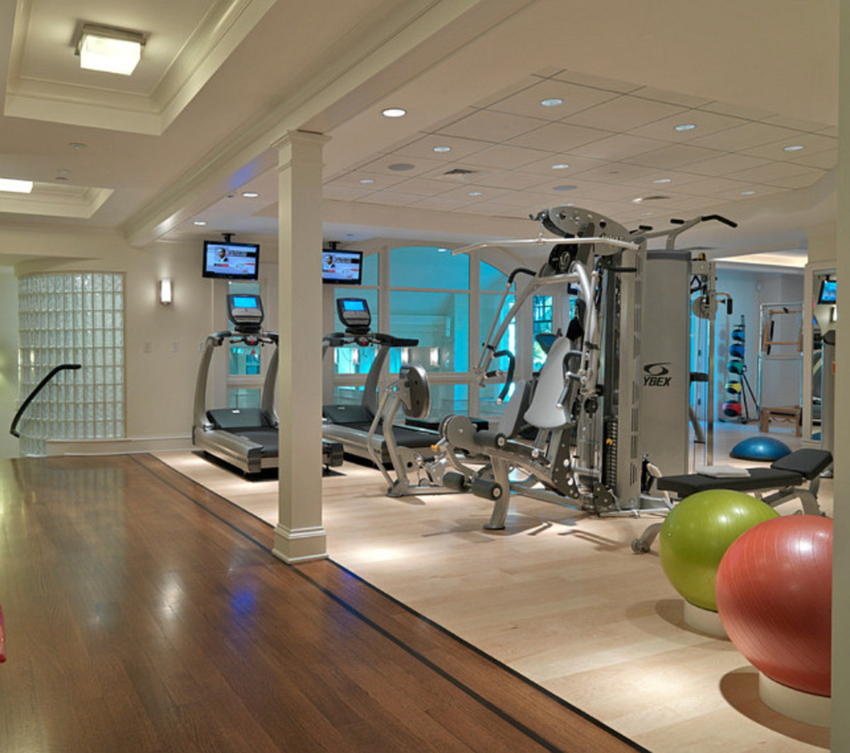 Light Dark and Medium Wood Tones in a fitness room = Surprised Elegance