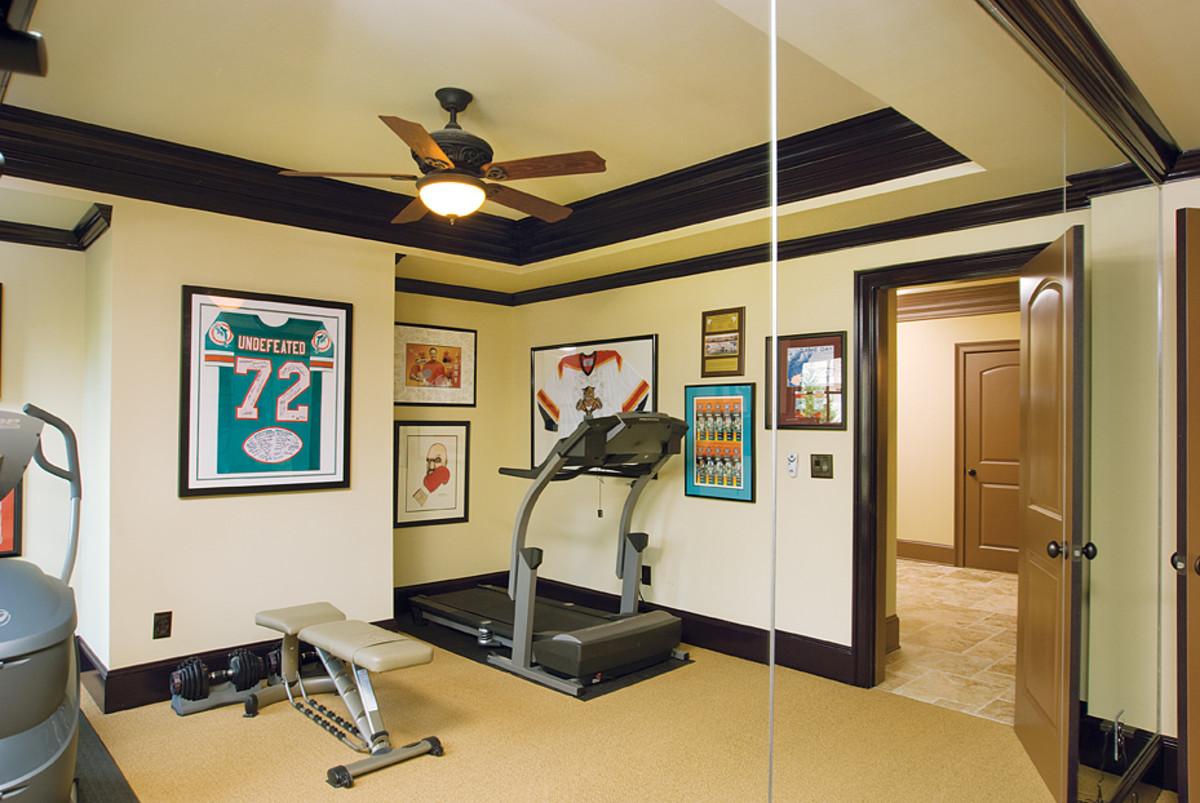 Dark Wood Cove Molding in a Home Fitness Room