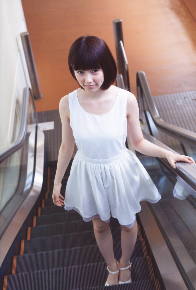 Haruka Shimazaki going up the escalator.