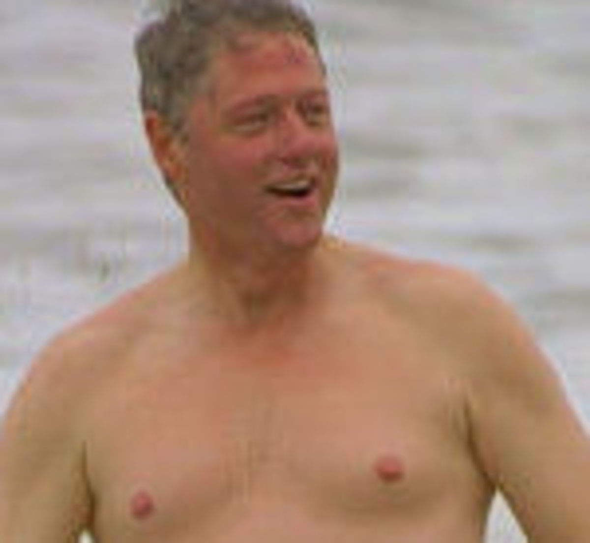 The older and chubbier Bill Clinton has similar shoulders.