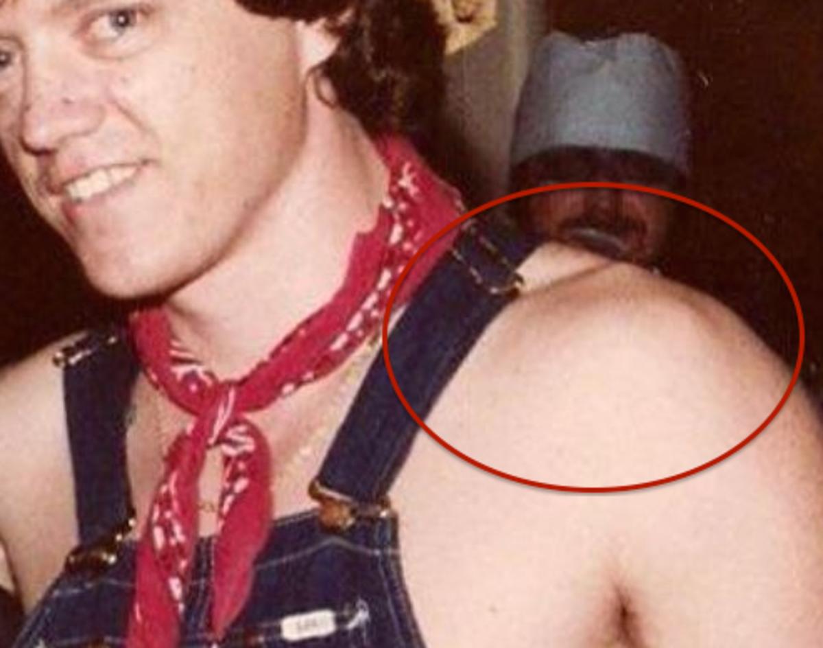 The slender man in the photo has visible shoulder bones.