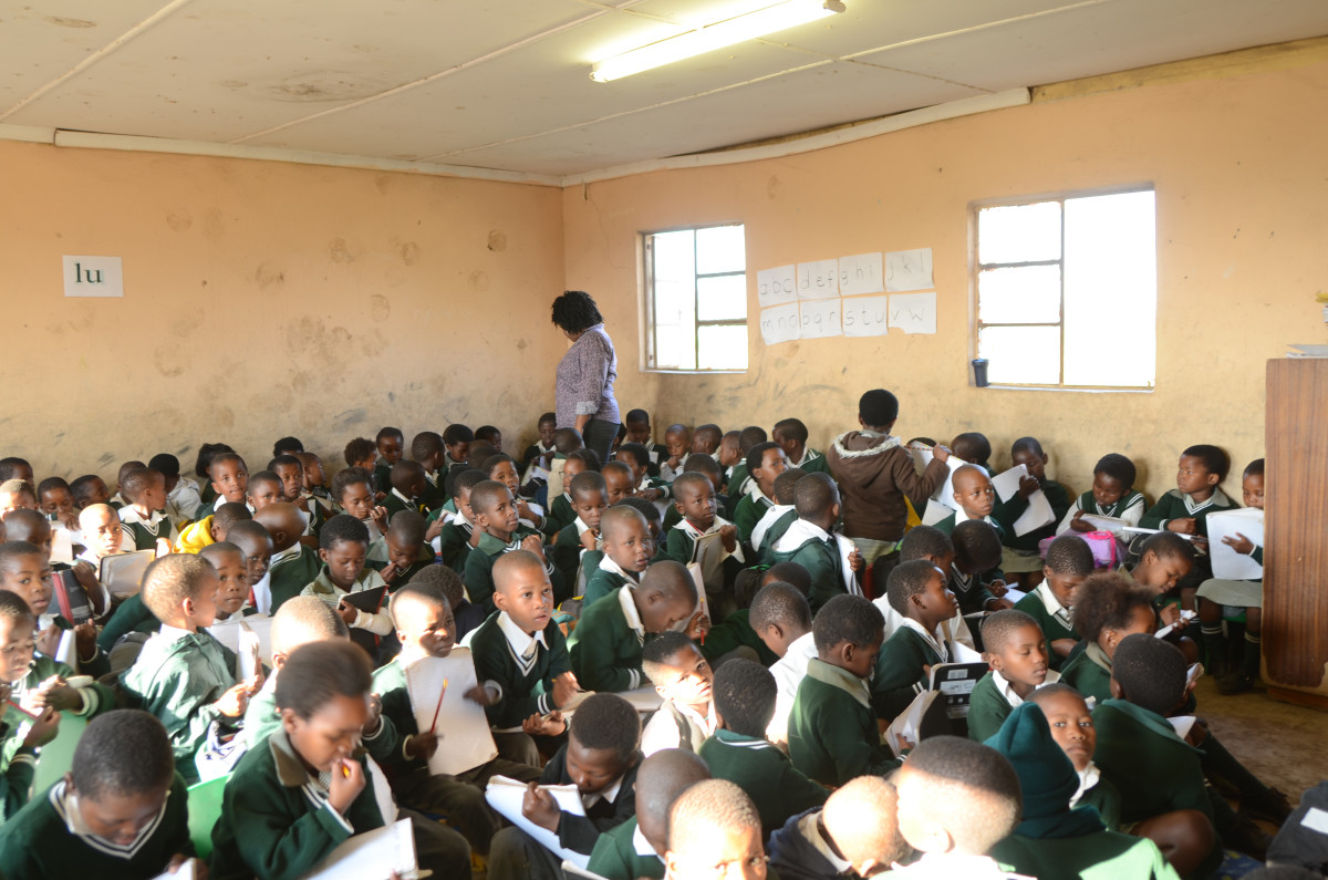 How can our children do any better by the time they reach Matric, when in their lower Primary classes this is the situation they have to deal with, no desk and one teacher for all.. Just like during the Apartheid days, if not worse...