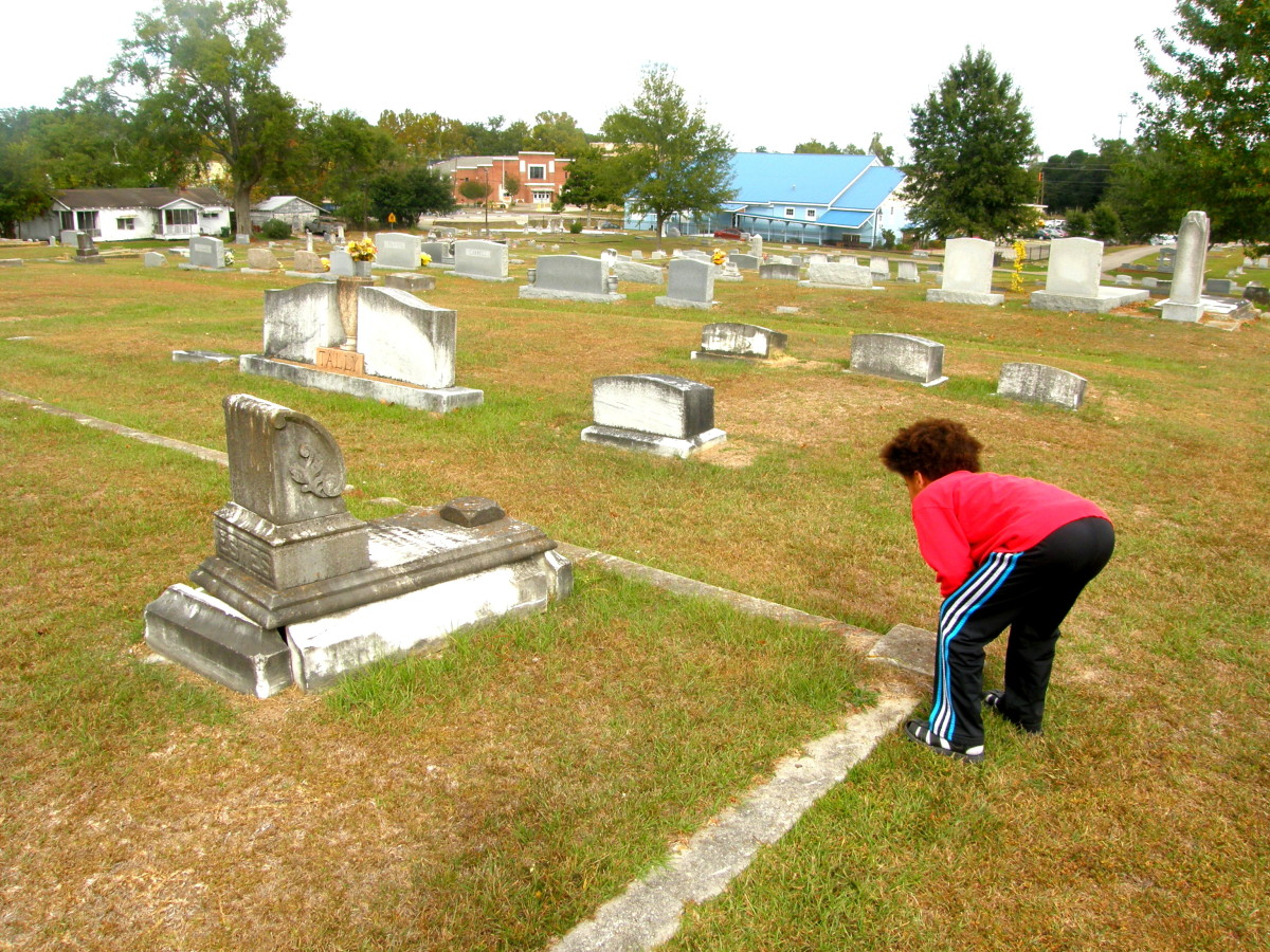 My youngest son keenly reading a tombstone.