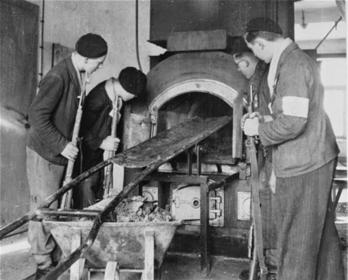 French Resistance fighters inspect one of the ovens in the Crematorium of Natweiler -Struhof Concentration Camp, Alsace N E France