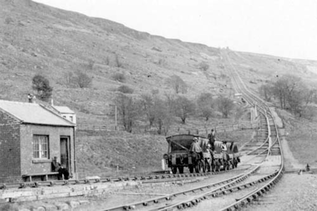 Steel-bodied mineral wagons begin haulage to the top with 'passengers' - although against the rules operators turned a blind eye. There was no passenger service and beyond Blakey there was only the brake van to ride in to Rosedale (ca 1900) See below