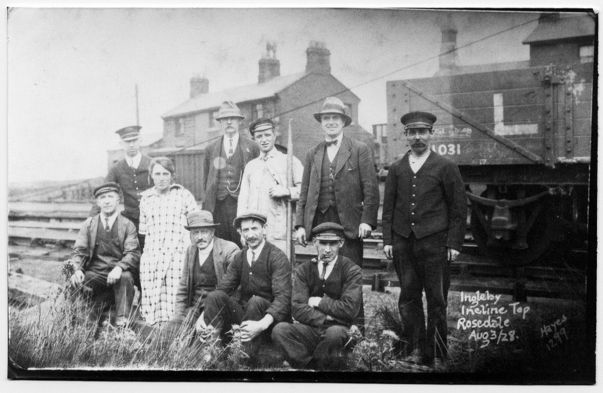 A post Grouping (1923) gathering at Incline Top poses for the camera. The wagon on the right shows its ownership as 'LMS', possibly ex-Midland Railway or London & North Western Railway