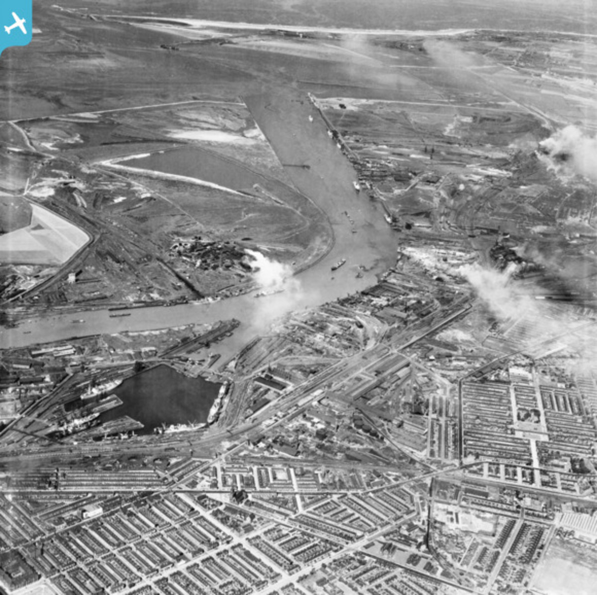 In the foreground in this view from the 1950s are Middlesbrough Docks, further along is Cargo Fleet and the railway to Redcar
