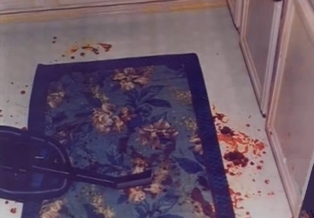 Rug in front of the sink. Blood drops on top of drops found here indicate that Darlie stood here bleeding for some time. It's believed this is where she stood and cut her throat and arm. The blood here was identified as hers