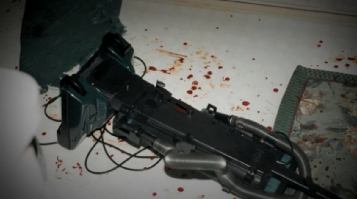 The vacuum cleaner in the kitchen with blood underneath it. Obviously placed there after the fact.