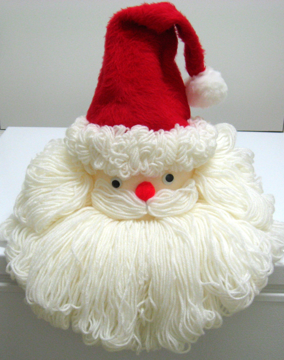 A bleach bottle is the base for this yarn Santa face.