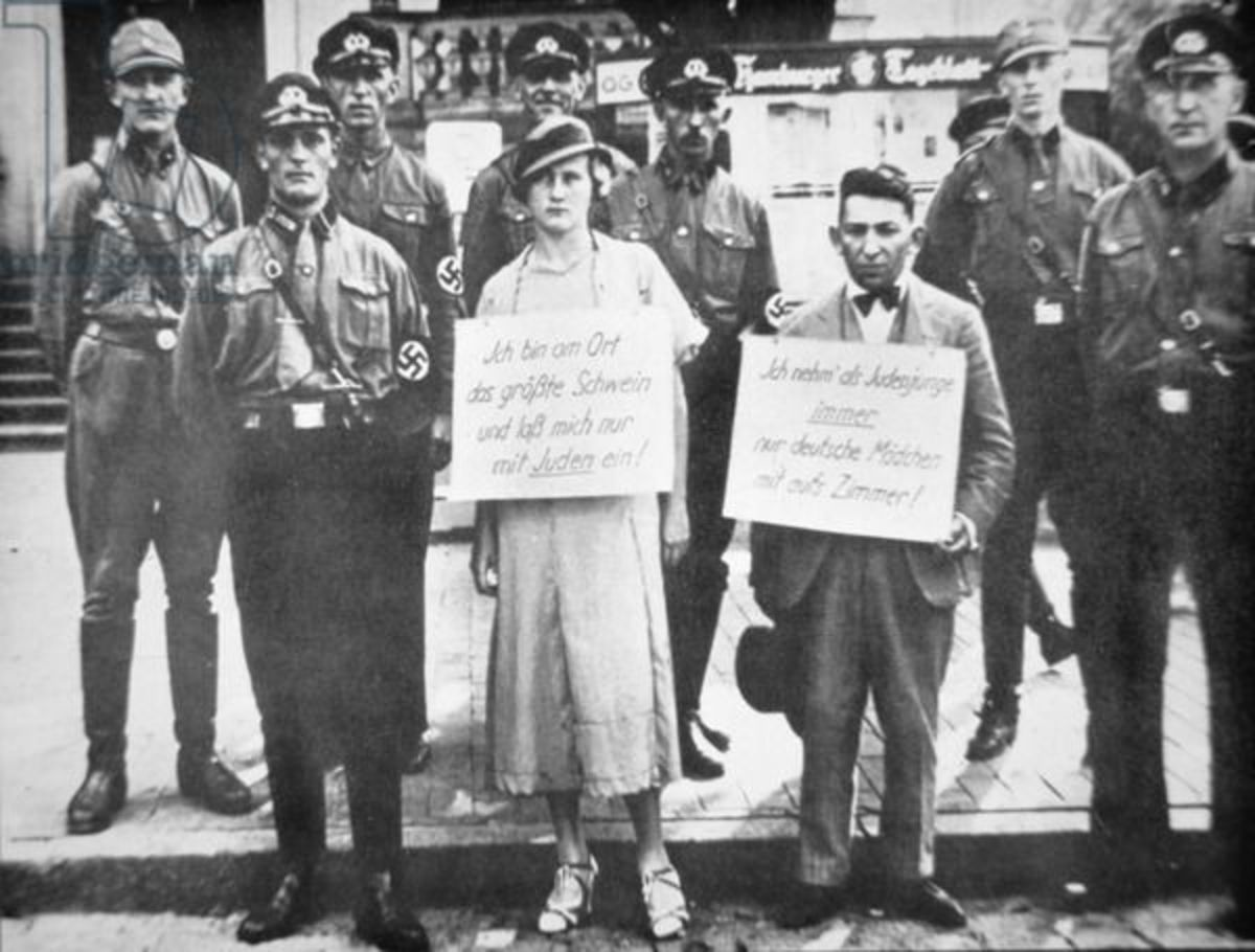 15 Sep Nuremberg Laws deprive German Jews of citizenship. This is an image of Nazi police publicly humiliating and shaming a German woman and a Jewish man for sleeping together.