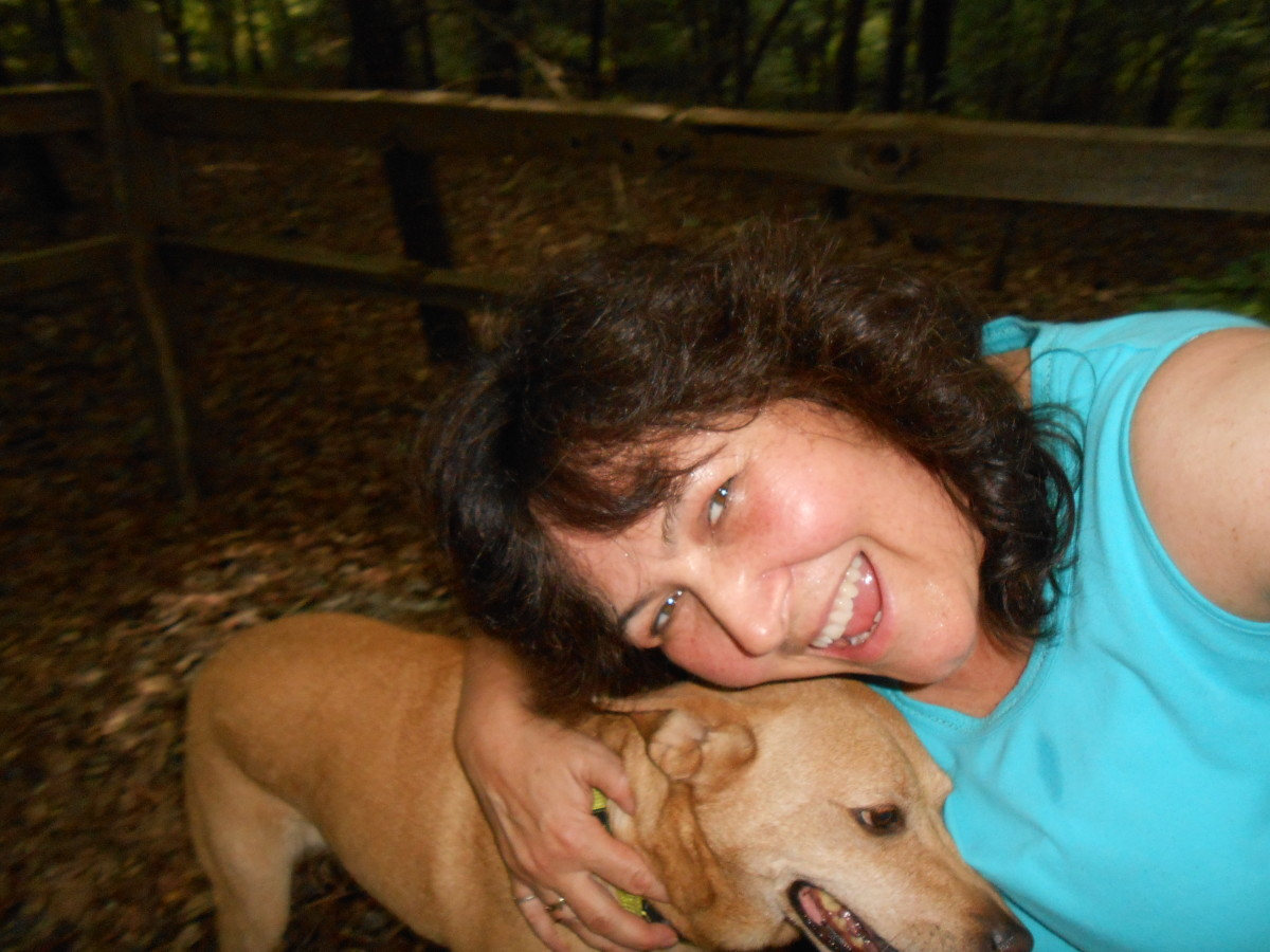 My personal trainer and I tired and sweaty but happy after a walk on a trail on a hot August day.