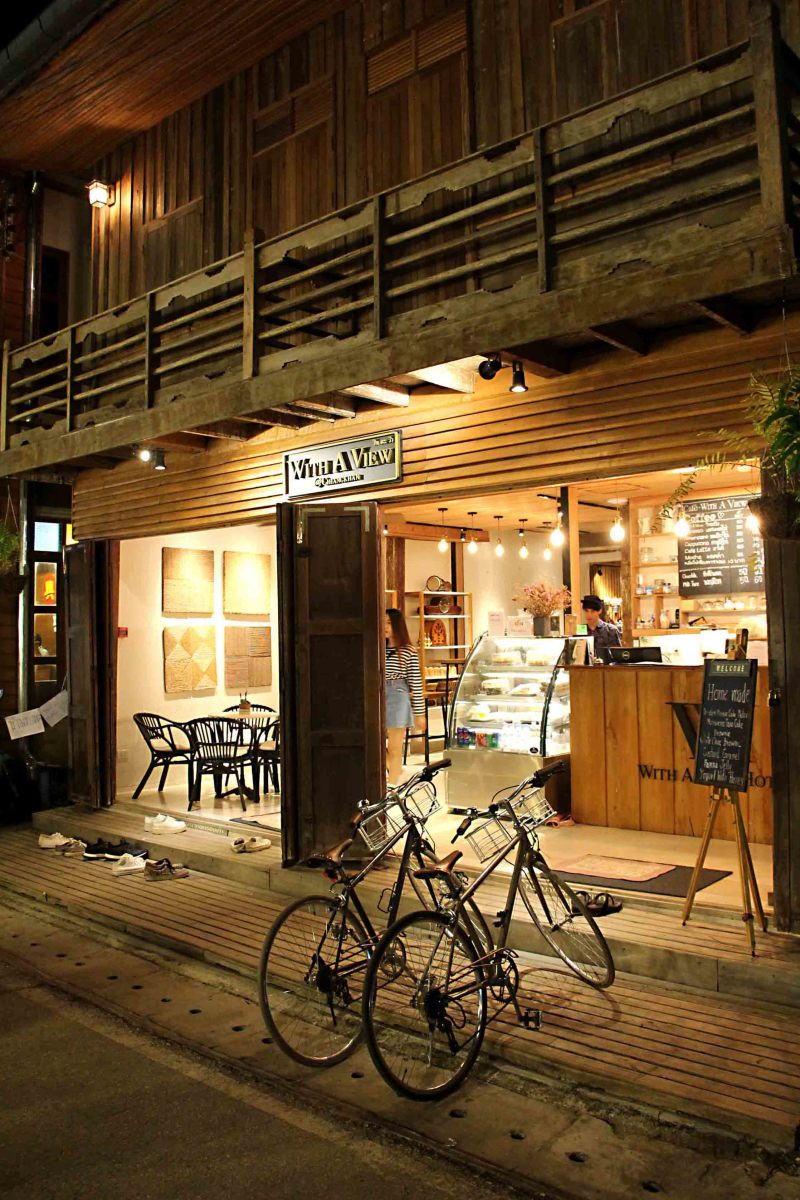 A teakwood shopfront and two bicycles - it could only be Chiang Khan