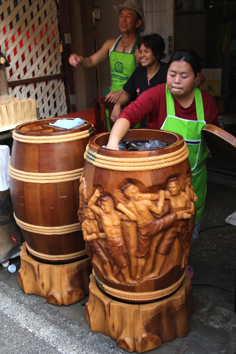 These ornately carved wooden barrels are a feature of the street. Bottles of drink are placed into the barrel which is packed with ice and water and salt, and gently rotated to keep them as cool as possible