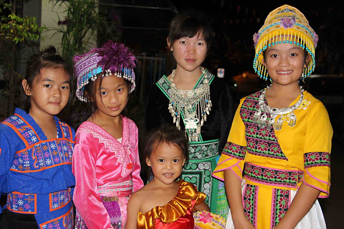 A troupe of young Walking Street entertainers in traditional dress