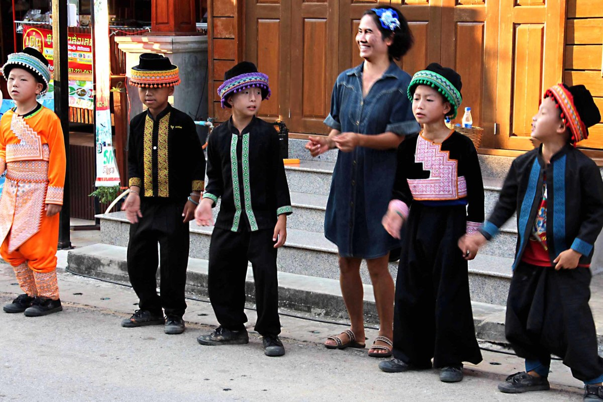 A children's dance troupe from the Khaokho District of Petchabun Province perform in costume for the tourists