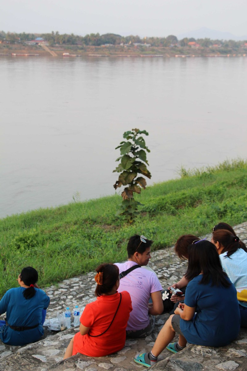Sitting and watching as the great River Mekong flows past