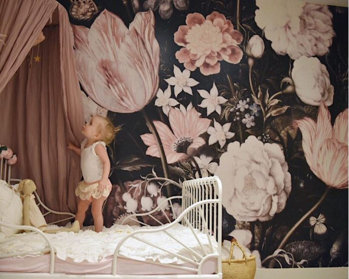 The chic and sophisticated floral wall mural is a real feature of this room.