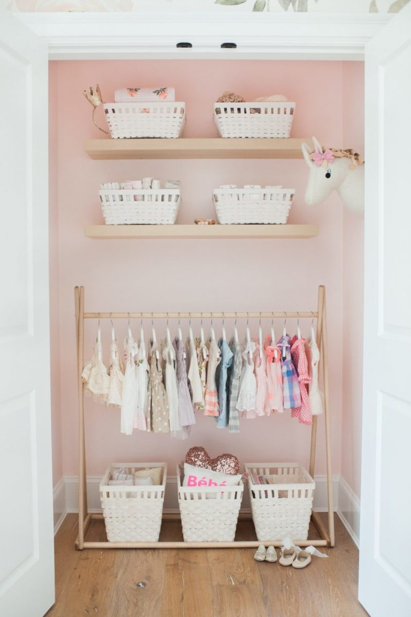 A cute closet with a light pop of color and a special whimsical touch.