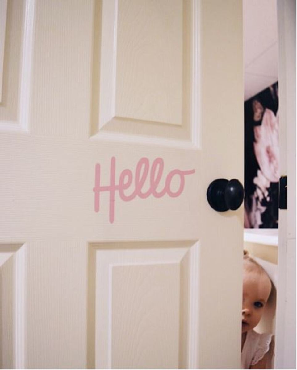 Small, but cute touches like this hello door sticker make this room age appropriate.