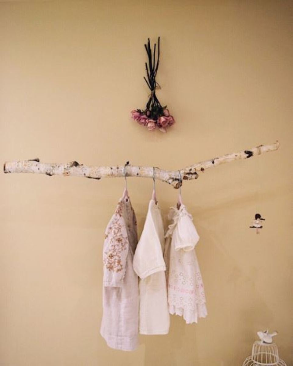 Natural elements like the branch rail add a nice whimsical feel to this room.