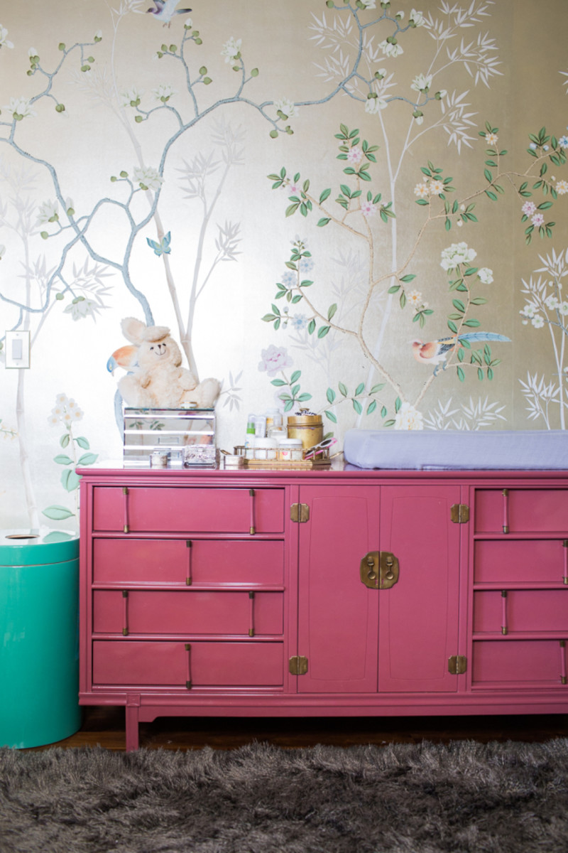 The oriental wallpaper & pink dresser are feature pieces in this room.