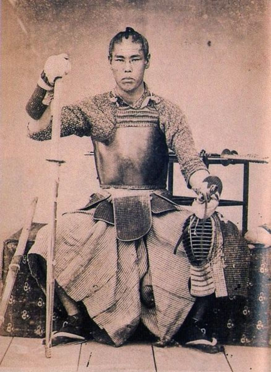 Kendo practitioner wearing his armor and holding his bamboo sword.
