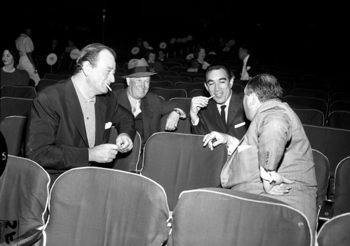 John Wayne, Maurice Chevalier, Anthony Quinn and Jerry Wald during 1958 Academy Awards rehearsals.