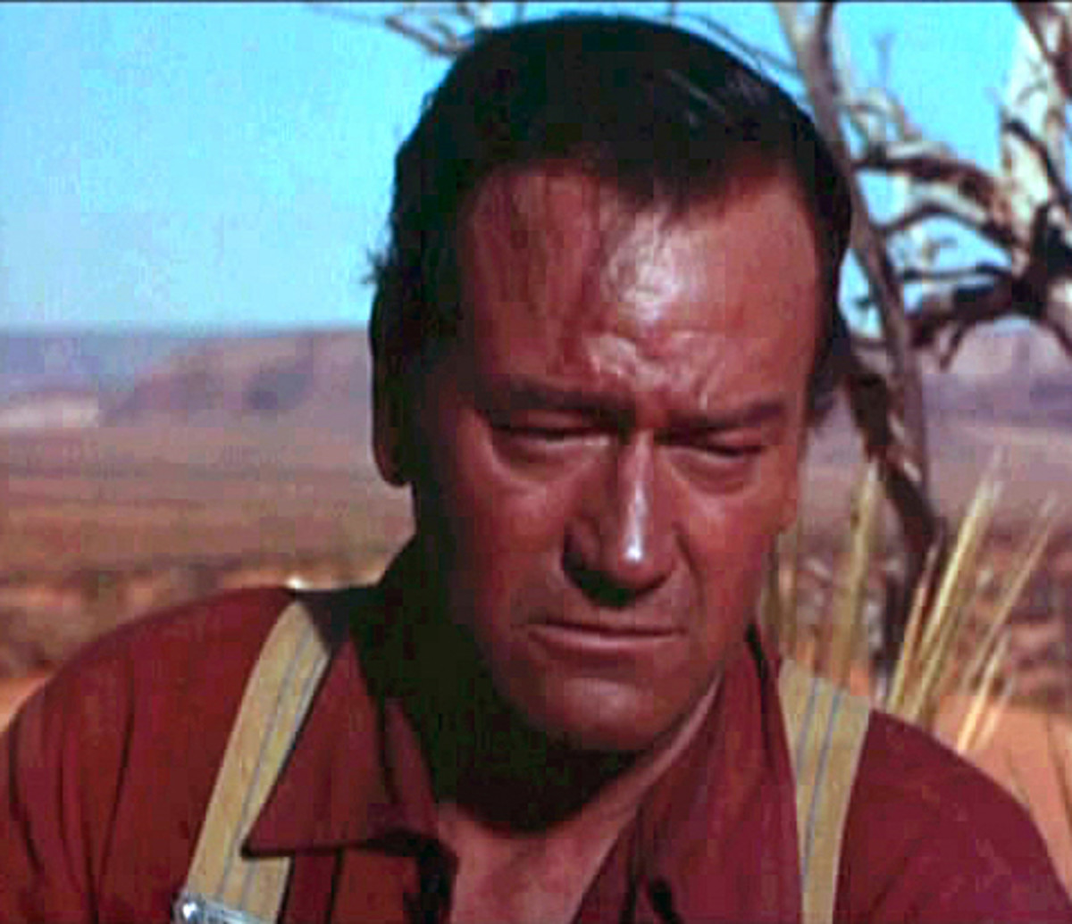 "John Wayne in a trailer screenshot from ""The Searchers."""