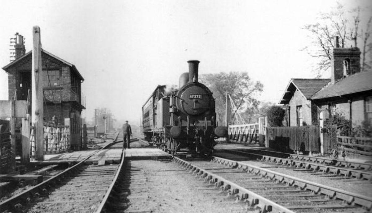 Mill Lane Junction, with Class G5 0-4-4 tank engine 67273 of Malton shed (50F)  bound for Gilling before 1953. The crossing keeper's cottage on the right is still there, a short way from a pair of railwaymen's cottages (left behind photographer)
