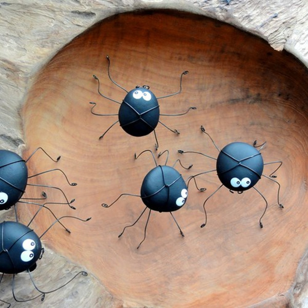 Finish your painted Halloween spider rocks with some thin wire or pipe cleaners for legs.