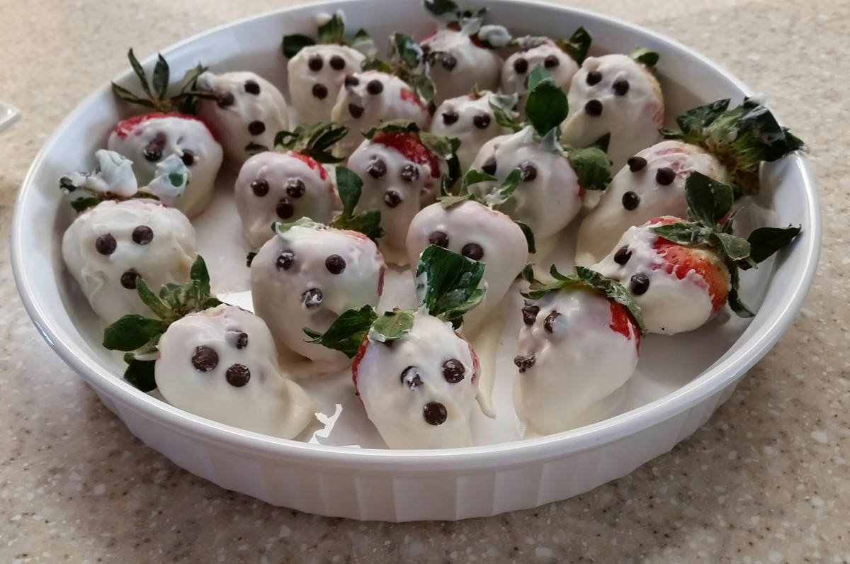 A neighbor made these fun ghost or skeleton faces. Wash, then dry strawberries. Dip them in white chocolate. Use mini-chocolate chips or chocolate icing to make the face.