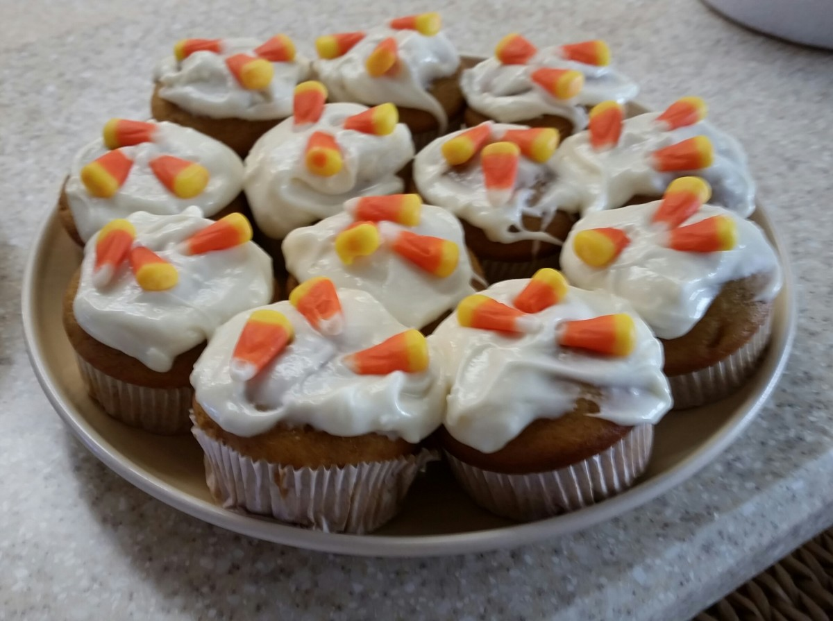 It doesn't get much easier than this. The cupcakes can be any flavor but I suggest pumpkin or a spice cake. Any icing is fine. I like a cream cheese. Then top it with some candy corns.