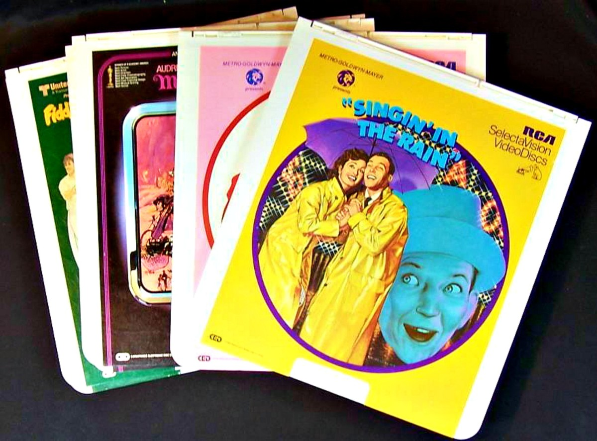 RCA SelectaVision CED video discs, four Musicals, FIddler, My Fair Lady, GiGi, and Singing in the Rain.