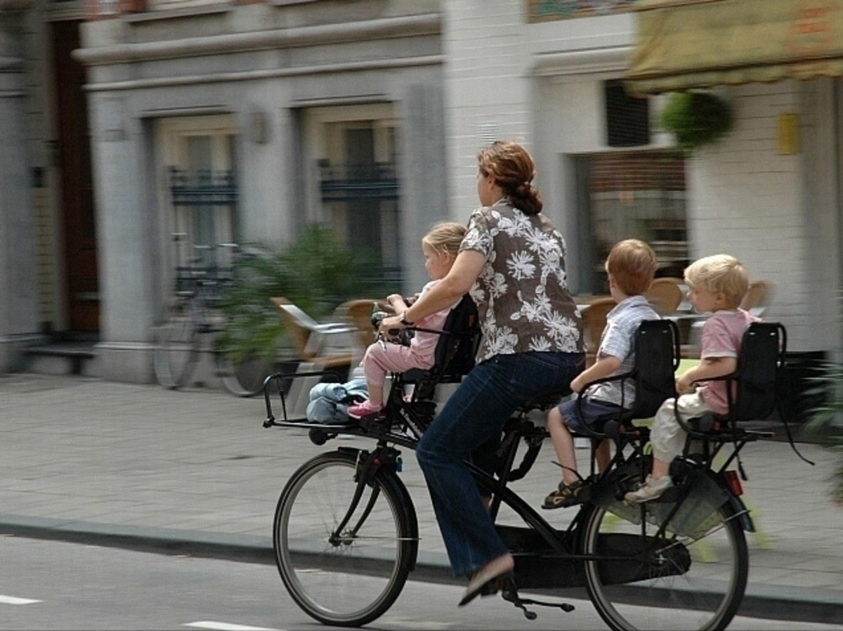 Cycling in the Netherlands with kids at the front and back is common...
