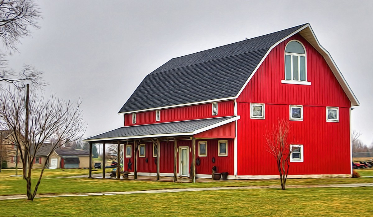 A lean to is attached to one side of a stable building. This barn is displaying this style of construction which is suitable for many uses. The remaining three sides may be covered or left open.