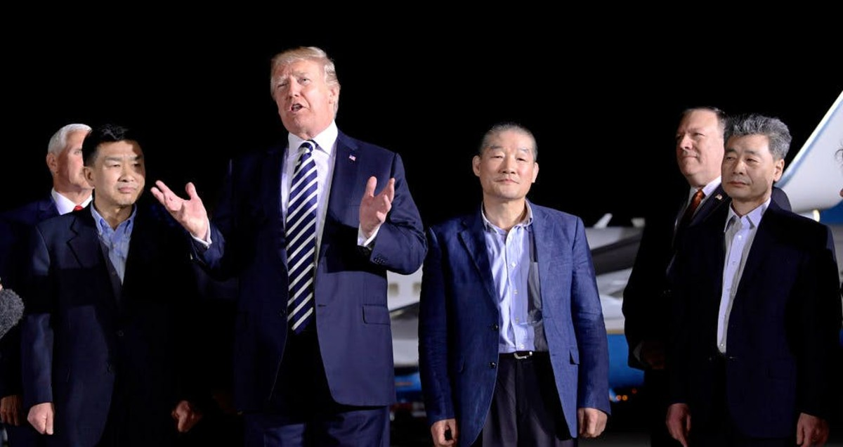 Trump stands with Americans recently released from North Korea.
