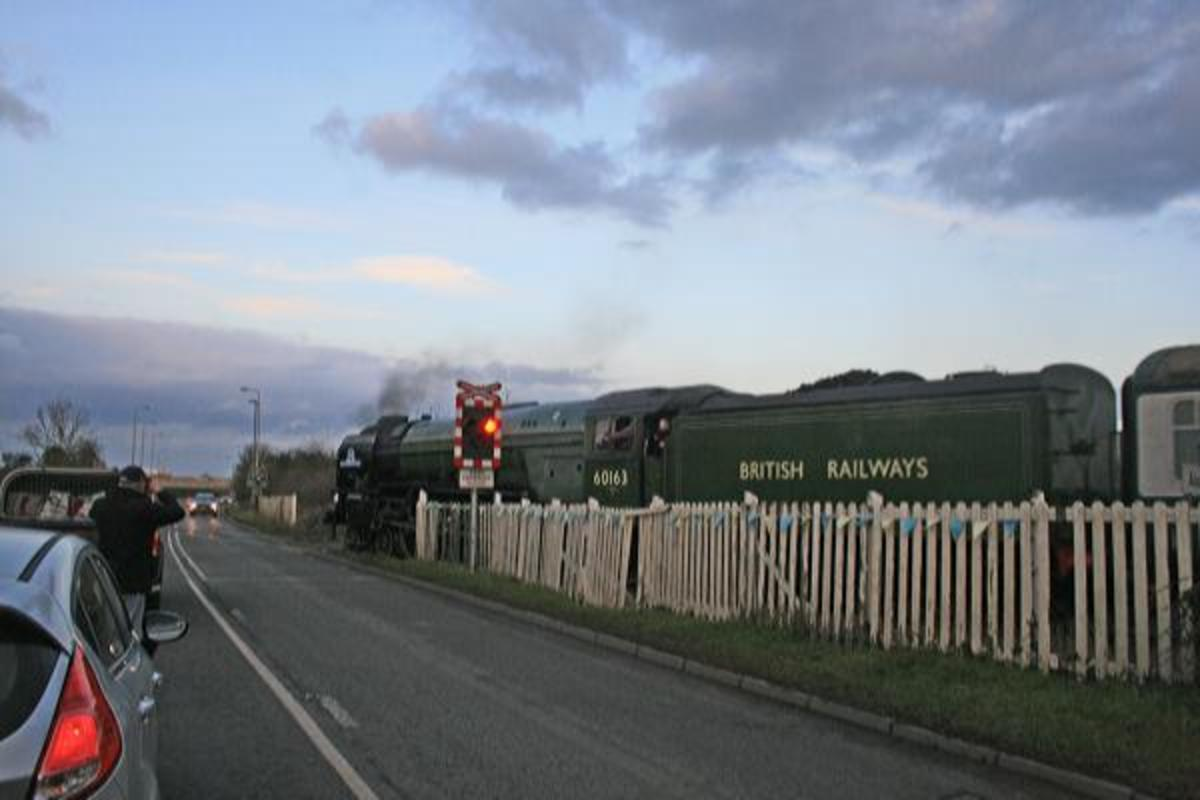 Tornado' trundles onto Aiskew Crossing (with the warning lights flashing) on her way between Leeming Bar and Bedale with a train for Redmire